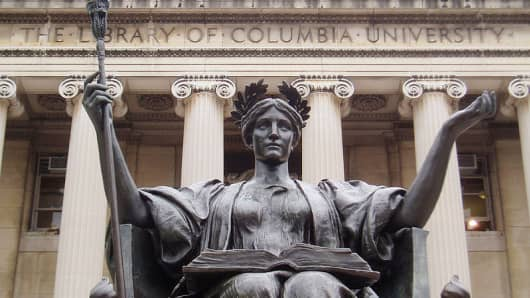 The statue Alma Mater in front of Low Memorial library on the campus of Columbia University.