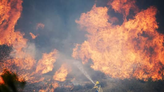 Hundreds of firefighters are battling wind and dry conditions as over 6,000 acres have already burned northwest of Los Angeles.
