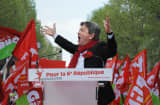 ean-Luc Melenchon, leader of Front de Gauche (Left Front) left wing party, gestures as he gives a speech on May 5, 2013 in Paris, during a demonstration called by him to protest &#039;against the austerity, against the finance and to ask for a Sixth Republic&#039;.