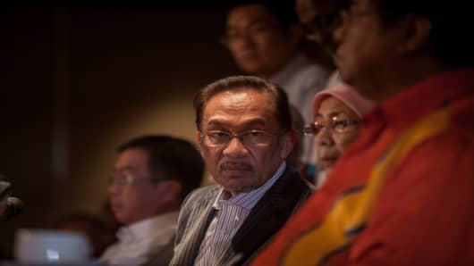 Anwar Ibrahim, Malaysia's opposition leader, listens during a news conference on Sunday, May 5, 2013.