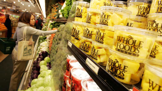 A customer shops for produce at a Whole Foods Market in San Francisco.