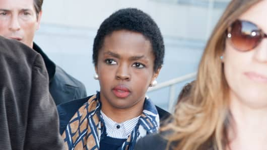 Lauryn Hill leaves court in Newark, N.J. Hill pleaded guilty in June 2012 for failing to pay federal taxes on $1.8 million earned from 2005 to 2007.