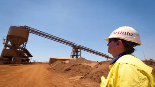 A mine worker looks at a train loader at Rio Tinto Group's West Angelas iron ore mine in Pilbara, Australia.