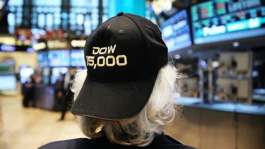 A trader on the floor of the New York Stock Exchange wears a hat embroidered with 15,000 at the end of the trading day on May 7, 2013 in New York City.
