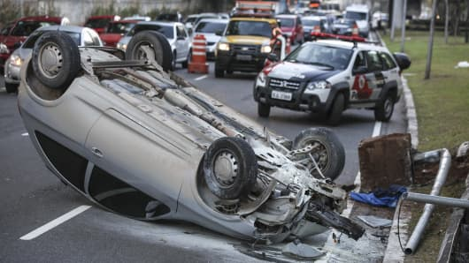 View of an overturned car in an accident on Ruben Berta Avenue on October 20, 2012 in Sao Paulo, Brazil.