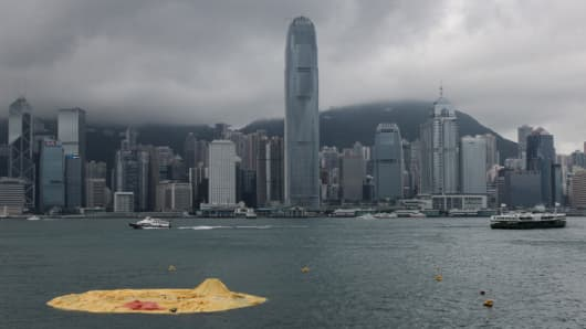 The 16.5-metre-tall inflatable Rubber Duck art installation lies deflated in Hong Kong's Victoria Harbour on May 15, 2013.