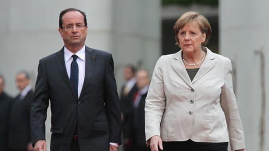 144355396SG002_Merkel_And_H