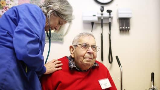 Registered nurse JoAnn Brand (L) examines Sham Tavakoli at the Lifelong Medical Marin Adult Day Health Care Center.