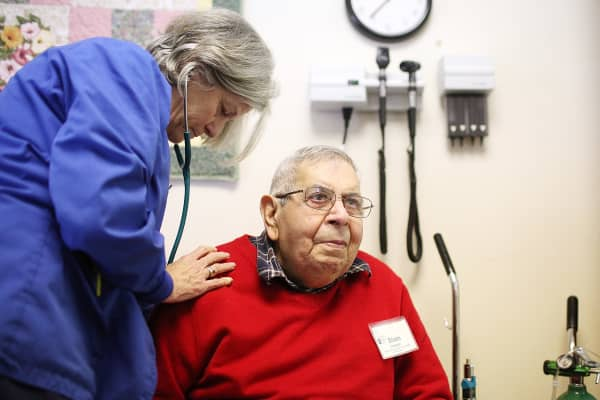 Registered nurse JoAnn Brand (L) examines Sham Tavakoli at the Lifelong Medical Marin Adult Day Health Care Center.