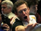 A trader signals an offer in the Standard & Poor's 500 stock index options pit at the Chicago Board Options Exchange.