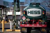 A Hess truck sits at a fueling station at the company&#039;s petroleum terminal in Bogota, N.J.