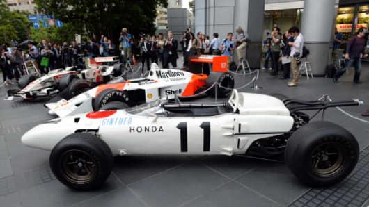 The three-generation Honda Formula One cars, (front to rear)1965 Honda RA272, 1988 McLaren Honda MP4/4 and 2006 Honda RA106.