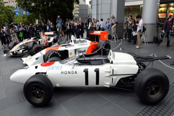 The three-generation Honda Formula One cars, (front to rear)1965 Honda RA272, 1988 McLaren Honda MP4/4 and 2006 Honda RA106.
