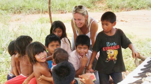 "Roberta Giassetti of Axé Italia Onlus with ""street children"" in Brazil."