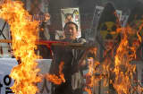 South Korean protesters burn a mock-up of a North Korean missile during a demonstration in 2012.