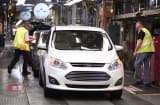 A Ford C-MAX plug-in hybrid vehicle comes off the assembly line at the Michigan Assembly Plant.
