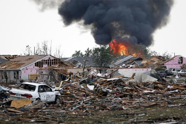 Fire burns in the aftermath of a deadly tornado in Moore, Oklahoma.