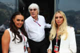 Bernie Ecclestone is seen at his motorhome with his daughters Tamara Ecclestone (L) and Petra Ecclestone (R).