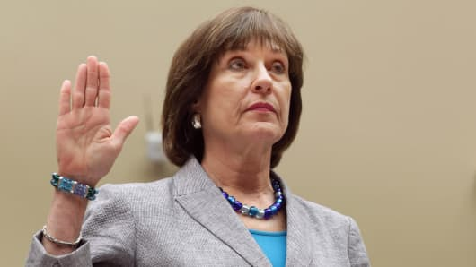 The IRS' Lois Lerner is sworn in before testifying on Capitol Hill.