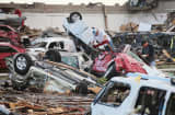 Residents search through rubble after a powerful tornado ripped through the area on May 21, 2013 in Moore, Oklahoma.