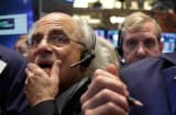 A global stock market slump is continuing on Wall Street as traders worry about how committed the Federal Reserve remains to keeping up its bond-buying program.