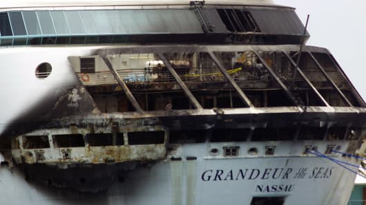 The fire-damaged exterior of Royal Caribbean's Grandeur of the Seas cruise ship is seen while docked in Freeport, Grand Bahama island, Monday, May 27, 2013.