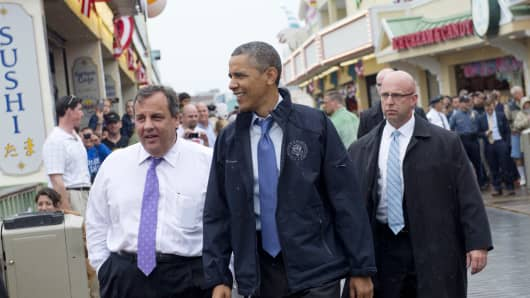 President Barack Obama and Gov. Chris Christie (L) walk along the Point Pleasant, N.J., boardwalk as they view rebuilding efforts following Hurricane Sandy.