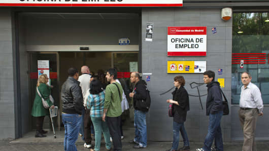 Jobseekers are seen entering an employment office after the opening in Madrid, Spain.