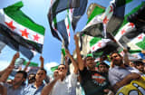 Protestors wave Free Syria's flags and chant slogans during a demonstration