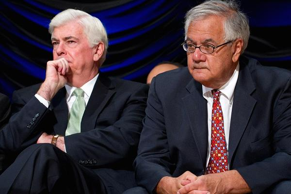 Then-Sen. Chris Dodd (L) and then-Rep. Barney Frank at the signing of the Dodd-Frank act in 2010.