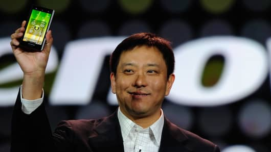 President of Lenovo shows the new Lenovo smartphone at the 2012 International Consumer Electronics Show