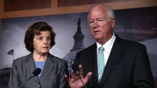 Chairman and vice chairman of the U.S. Senate Select Committee on Intelligence, Sen. Dianne Feinstein (D-Calif.), left, and Sen. Saxby Chambliss (R-Ga.) speak to members of the media. According to reports, the NSA has collected phone data, under a provision of the Patriot Act, of Verizon customers in the U.S.