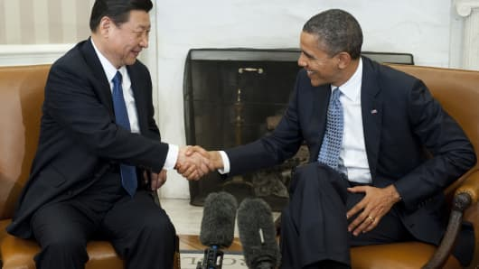 Barack Obama shakes hands with Xi Jinping at a meeting last year. Xi took full power in China in March of 2013.