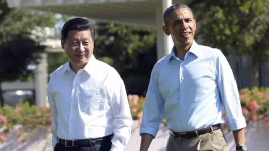 Barack Obama (R) and Xi Jinping