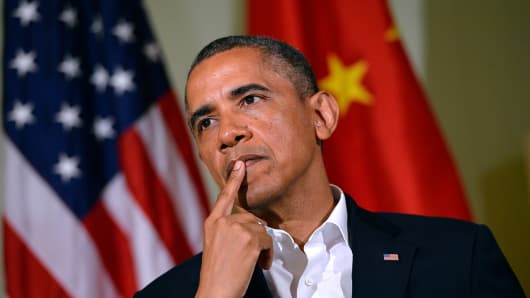 President Barack Obama listens as Chinese President Xi Jinping answers a question following their bilateral meeting at the Annenberg Retreat at Sunnylands in Rancho Mirage, California, on June 7, 2013