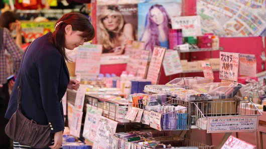 A woman looks at cosmetics at Ameyoko market in Tokyo, Japan. The government revised annualized GDP growth for January-March to 4.1 percent from an earlier reading of 3.5 percent on Monday.