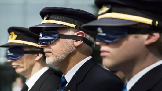 Pilots protest proposed new regulations outside the European Aviation Safety Agency in May 14, 2012 in Germany