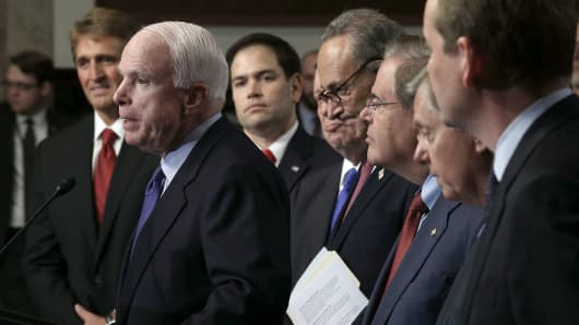 Sen. John McCain (R-AZ) (2nd L) speaks as (L-R) Sen. Jeff Flake (R-AZ), Sen. Marco Rubio (R-FL), Sen. Richard Durbin (D-IL), Sen. Chuck Schumer (D-NY), Sen. Bob Menendez (D-NJ), Sen. Lindsey Graham (R-SC), and Sen. Michael Bennet (D-CO), also known as the Gang of Eight