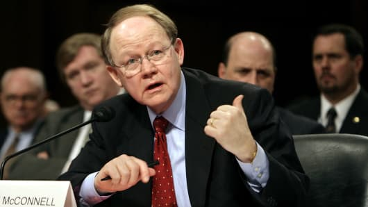 Former National Intelligence Director John McConnell, testifying before the Senate in 2007, is vice chairman of Booz Allen Hamilton.