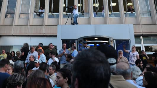 Thousands of demonstrators gather outside the Greek public television and radio broadcaster ERT headquarters in Athens northern suburb, after Greece's government announced on June 11, 2013 the immediate closure of ERT in a move that reportedly affects about 2,700 jobs