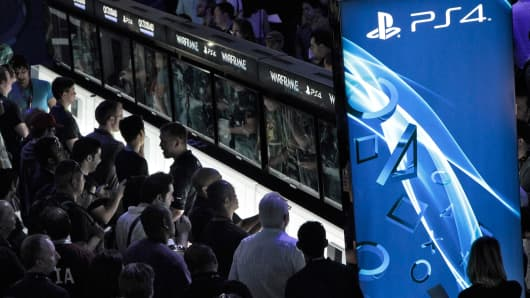 Attendees try out Sony Playstation 4 at the E3 Electronic Entertainment Expo in Los Angeles, CA, June 11, 2013