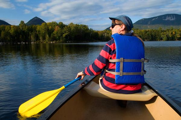 Woman canoeing in Baxter State Park, Kidney Pond, Maine