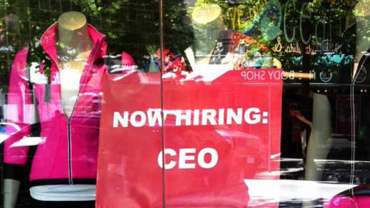 A CEO Help Wanted sign is on display inside a Lululemon storefront in Toronto.