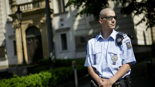 A policeman stands in front of the Czech Government headquarters. Several people were arrested by the police squad for uncovering organised crime (UOOZ) at the Czech Government offices after a cabinet meeting.