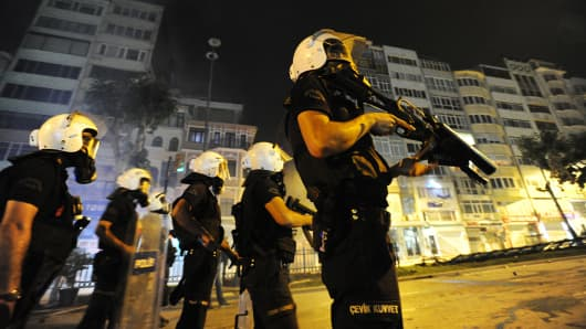 Turkish police firing tear gas battle anti-government protestors after recapturing Gezi Park near Taksim Square, after an absence of 17 days in the heart of Istanbul, Turkey, on June 15, 2013.