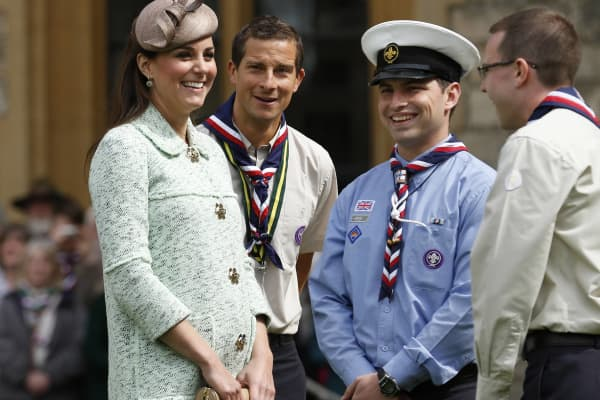 Catherine, Duchess of Cambridge talks with Chief Scout Bear Grylls (2nd L) and Sea Scout Rob Butcher (2nd R) as she attends the National Review of Queen's Scouts at Windsor Castle on April 21, 2013.