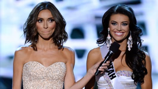 Television personality and host Giuliana Rancic (L) looks on as Miss Utah USA Marissa Powell answers a question from a judge during the interview portion of the 2013 Miss USA pageant.