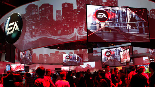 Attendees visit the Electronic Arts (EA) Inc. display at the E3 Expo in Los Angeles, California.