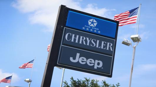 A Chrysler Jeep sign is seen in front of a dealership in Hollywood, Florida.