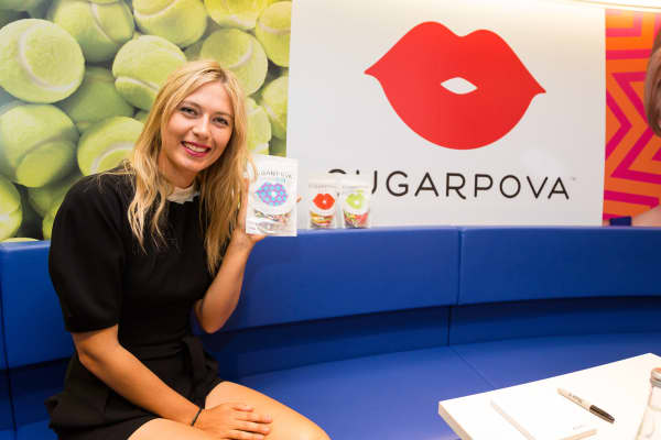Tennis player Maria Sharapova poses with a Sugarpova candy packet during the French launch of her Sugarpova candy collection.